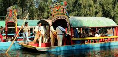 Mariachis board a boat at Xochimilco floating city