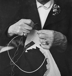 Madame Blanchot sewing on wire to the outer edge of the brim of the sparterie hat base that she had previously cut on the head of the customer. WOW! ca. 1940's. Photo by Roger Parry. French Photographic Archives. #millinery #judithm #hats