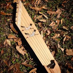 A beautiful sounding 5-string kantele. Pyrographed sandhill cranes on the birch soundboard. Ponsi and peg holder made from ambrosia maple.   Uses standard zither pins. Comes with tuning key.
