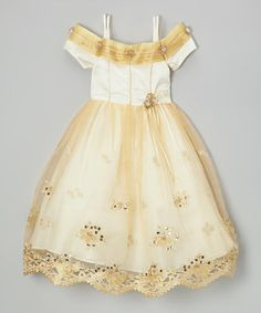 Little girls are set for the ball in this gorgeous frock. It's a vision in sequins, flouncy layers and a sheer bow in the back. Plus, the dreamy colors and off-shoulder silhouette are perfect for pint-size princesses.