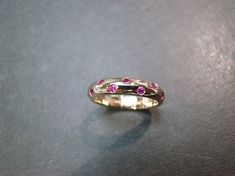 14K rose gold ruby band as an engagement ring, wedding band, anniversary gift, or a personalized jewelry. Product Specifications: Type: Natural Ruby Number of Gemstones: 7 Total Carat: Approx. 0.12ct Precious Metal: 14K Gold Ring Width: 3.90mm Currently made to order pieces may take