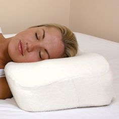 SIDEPIL. The pillow's airflow system maximizes airflow to improve breathing. Cream, cotton velour cover is removable for washing. The full facial cradle offers soothing comfort while reducing pressure on the jaw and ear and the shoulder cradle provides orthopedically correct support for the head and neck, which means proper spinal alignment, less impact from body weight on the shoulder, and improved circulation. Also available at Relax The Back® nationwide.