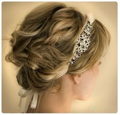 A lovely, understated updo adorned with a headband that ties underneath!