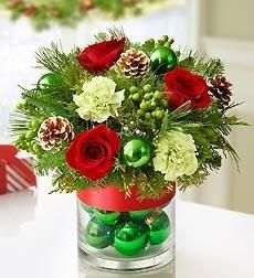 CHRISTMAS FLOWERS- This is great inspiration to make your own centerpiece. (It would be really pretty with white roses and silver Christmas balls too!)