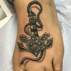 Lighthouse anchor tattoo