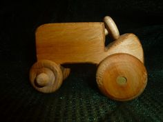 https://www.etsy.com/listing/176632211/handmade-small-wooden-tractor