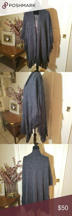 PLUS KNIT OPEN FRONT PONCHO One size fits most plus sizes   This is a poncho/shawl that is heavier to keep you warm and is so soft, you'll want to cuddle up with it on.  Can be warn over any outfit including tops and dresses.  Has frayed ends  Color is a dark grey/blue  ***note that the model is not wearing the exact same color/style of this poncho. Those pics are for style visualization only*** **they are from the same boutique brand** WILA Sweaters Shrugs & Ponchos