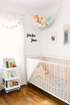 Clever pastel baby nursery - Love the use of the rolling cart to hold books and accessories as well as the ceiling net to hold soft toys! - Unique Nursery Ideas & Decor - domino.com