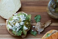 Pork tortas flavored with ancho and orange and topped with avocado, cilantro, and plenty of mayo are a great weeknight dinner.