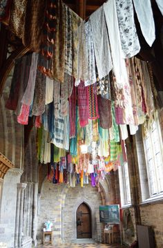 love this prayer flag ceiling... (these look like sarees)