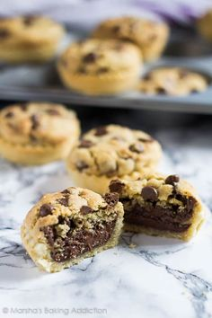 Nutella Stuffed Chocolate Chip Cookie Pies - These mini pies are made with an all-butter pastry stuffed with Nutella and topped with soft, and chewy chocolate chip cookie!