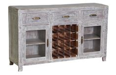 - Caelyn 3 Drawer 2 Door Buffet/Wine Cabinet -  Clean and crisp with a rustic edge, the Caelyn Buffet and Wine Cabinet is an instant classic. Crafted from Acacia wood and finished with a stunning, white wash this cabinet can conform to any style. With a built-in metal rack for 16 bottles, and ample storage for all your servers and dining accessories, the Caelyn Buffet and Wine Rack is an amazing find.  Dimensions: 60W x 16D x 36H Wood: Acacia Wood | Finish: Whitewash $1,087.00 + Free…