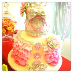 Beautiful baby girl birthday cake !! Love love love but no yellow. ...All brought green and pink