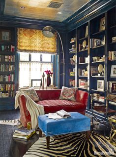 In this Washington, D.C. home, designers Hillary Thomas and Jeff Lincoln layered this library with lush fabrics and animal prints, alongside lacquered walls and a silver ceiling.