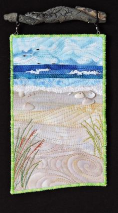 Everyday at the Beach is Different # 5.  A small fiber art quilt by Eileen Williams