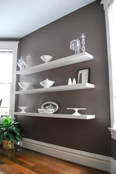 Lack ikea shelf on gray. I would make the objects on the shelf the accent color