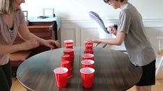 You'll need plastic cups and ping pong balls for this fun game. Can you bounce your ping pong ball into each cup the fastest? You'll need plastic cups and ping pong balls for this fun game. Can you bounce your ping pong ball into each cup the fastest? Easy Kids Party Games, Family Party Games, Indoor Activities For Kids, Family Game Night, Kids Fun, Fun Kids Games, Fun Games For Teenagers, Party Games For Adults, Kids Party Games Indoor
