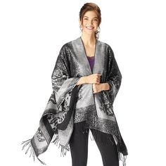 """Wrap yourself in luxury with this decadent 62"""" x 52"""" metallic-print shawl. Reversible print: metallic on one side matte on the other. One size. Polyester/acrylic. Hand wash, line dry. Imported."""