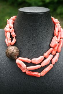 "Beautiful ""AAA"" grade highly polished natural coral accented with a copper focal bead"