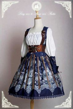 Steampunk dress with white blouse, leather arm things, leather corset things and leather strap things snicker the dress in a dark blue floral pattern