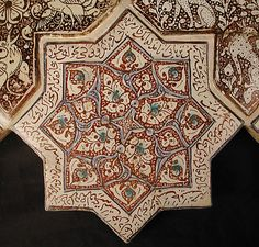 Star-Shaped Tile Object Name: Star-shaped tile Date: 13th–14th century Geography: Iran, probably Kashan Culture: Islamic Medium: Stonepaste; inglaze painted in blue and turquoise and luster-painted on opaque white glaze Dimensions: 8 x 8 in. (20.3 x 20.3 cm) Classification: Ceramics-Tiles Credit Line: H.O. Havemeyer Collection, Gift of Horace Havemeyer, 1941 Accession Number: 41.165.18