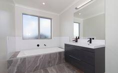 This bathroom includes a built in bathtub. Built In Bathtub, Bathroom Lighting, Mirror, Building, House, Furniture, Ideas, Home Decor, Bathroom Light Fittings