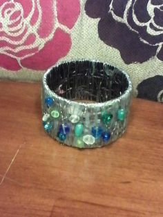 Hey, I found this really awesome Etsy listing at https://www.etsy.com/listing/191071747/up-cycled-wire-sea-glass-bangle