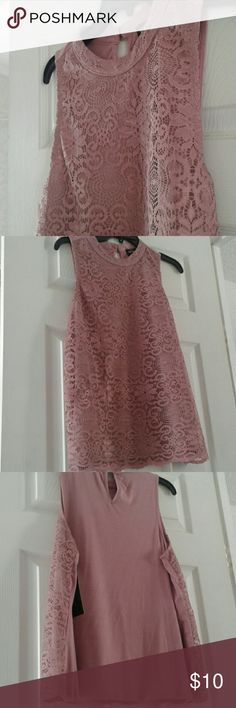 Eyelet Pattern Tank Pink tank with eyelet pattern. Tank has connected solid shirt that prevents it from being seen through. Fits US 10-12. Bundle to receive a great deal. Tempted Tops