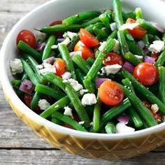 Balsamic Green Bean Salad    Ingredients:   •2 pounds fresh green beans, trimmed and cut into 1-1/2-inch pieces  •1/4 cup olive oil  •3 tablespoons lemon juice  •3 tablespoons balsamic vinegar  •1/4 teaspoon salt  •1/4 teaspoon garlic powder  •1/4 teaspoon ground mustard  •1/8 teaspoon pepper  •1 large red onion, chopped  •4 cups cherry tomatoes, halved  •1 cup (4 ounces) crumbled feta cheese