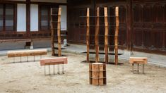 Shinkyu Shon's Split furniture contrasts wooden logs with mirrored steel