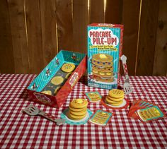 Benefits of The Pancake Pile-Up!™ Relay Game: 1. Develops gross motor skills. 2. Balance and coordination. 3. Teaches following a sequence, a beginning math skill. 4. Encourages social skills from teamwork to being a good sport.  $17.99