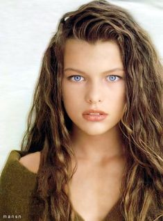 Milla Jovovich...I remember seeing pictures of her in my TEEN magazine wishing I had her gorgous blue eyes instead of my brown, lol.