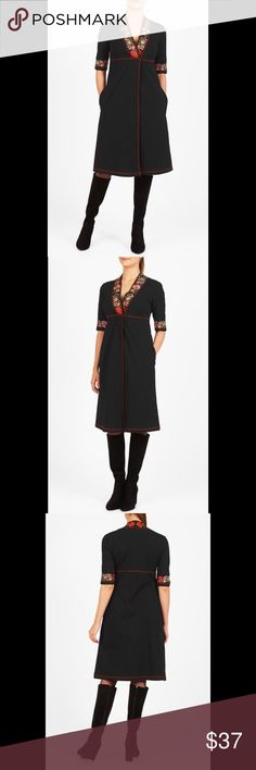 """New Eshakti Black Knit Sheath Dress 18W New Eshakti black floral embellished knit dress. Size 18W Measured flat: Underarm to underarm: 40"""" Empire waist: 38"""" Hips: 50"""" Length: 43 ½"""" Sleeve: 17 ½"""" Eshaki size guide for 18W bust: 45"""" Floral embellishment on low V neck & cuffs, contrast piped trim at center pleat front, empire waist.  Longer than photo bracelet length sleeves. . Cotton/spandex, jersey knit, light stretch, light structured feel, mid-weight.. Machine wash. New w/ cut out Eshakti…"""
