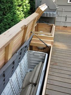 timber bench storage - with sealed plastic boxes within