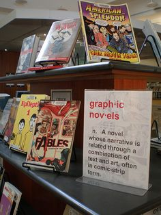 Graphic Novel Book Display August 2007 | Flickr - Photo Sharing! Love this idea to top my book shelves with.