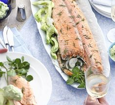 Foil-poached salmon with dill & avocado mayo. A whole poached salmon makes a buffet centrepiece with wow-factor - we've got ideas for using up the leftovers too