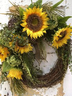 Summer Wreath, Fall Wreath, Sunflower Wreath, Front Door Wreath, Housewarming Gift,  These beautiful sunflowers will bring warmth and cheer to your front door. This wreath is filled with large sunflowers, greens, grass, a seed pod and a Black and Tan bow.  The finished size is 24 x 22 x 10.  Thank you for visiting my shop!  To view all the items in my shop, please click on this link: https://www.etsy.com/shop/FlowerPowerOhio?ref=hdr_shop_menu