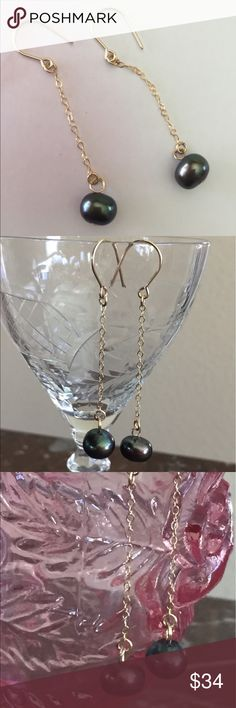Dangle Earrings These dangling earrings have a lot of movement. There is a 7mm Cultured Pearl at the end of a 14kt gold filled chain. Chain has sparkle and pearls have a high iridescence.  Great summer Accessory. Dress up or casual. Super pretty. Jewelry Earrings