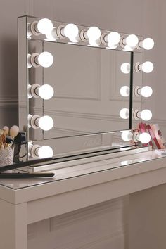 Vanity mirror with LED light bulbs around it to sit on your dressing table or wall mount it! Plug your hair dryers and straighteners into the mirror and control the level of light you need with the dimmer. Stunning!