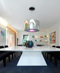 Contemporary dining room interior design with Corian dining table designed by MR. MITCHELL