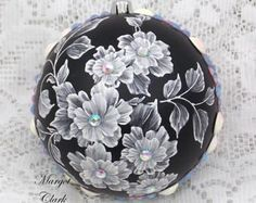 Red glass ornament with texture painted MUD floral design with added white pearl trim. My signature M is located on the bottom of the ornament. Measures 2 1/2 x 2 1/2