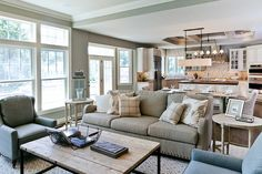Kitchen/greatroom- gray couch and light fixtures