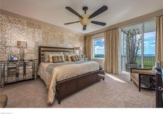 Transitional Guest Bedroom with flush light, Ceiling fan, Carpet, High ceiling…