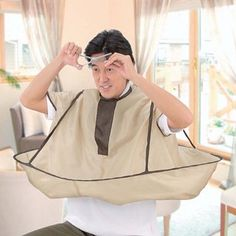 This cut-your-own-hair barber cape.   27 Crazy Amazing Products That'll Make Your Life Easier