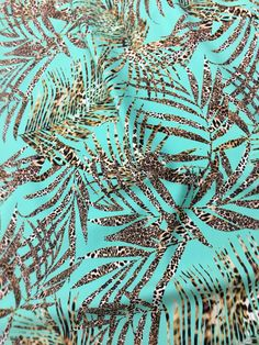 d01a7619621 New nylon 4 way stretch licra spandex blue green with a exotic print fabric  sold by the yard