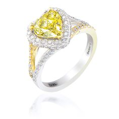 Gorgeous natural yellow heart shaped diamond in a split shank complimentary diamond ring.