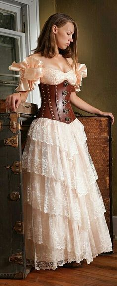 A Victorian-Edwardian Steampunk Wedding Dress w. Lace & Ruffles plus a Brown Leather Corset. c. 1890-1905.