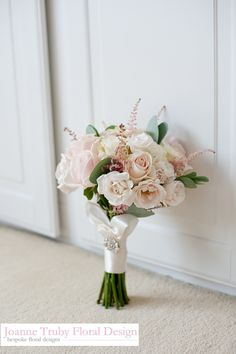 Made up of sweet avalanche roses, garden spray roses, white avalanche roses & astilbe by Joanne Truby Floral Design