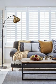 These full-height shutters - part of the Atmosphere range from the House Beautiful collection at Hillarys - cover the entire window for privacy and contemporary elegance. Choose a pale blue finish to create depth in a neutral living room. Living Room Windows, Living Room Grey, Living Room Modern, Living Room Sofa, Home Living Room, Living Room Designs, Small Living, Mustard Living Rooms, Interior Exterior