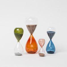 With its organic, soft shape and complementary combinations in clear and colored glass with fine sand, HAY's Time hourglass offers a contemporary twist on the classic hourglass timer. Get at Nannie Inez online. Hourglass Timer, Fine Sand, Paper Organization, Pine Forest, Colored Glass, Burnt Orange, Home Accessories, Objects, Classic